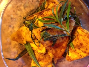 Butternut squash triangoli (Trader Joe's) sauteed in butter with cinnamon and fresh tarragon.